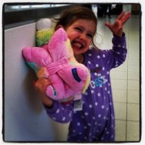 Ella smuggling toys in her Jammies through Airport security.